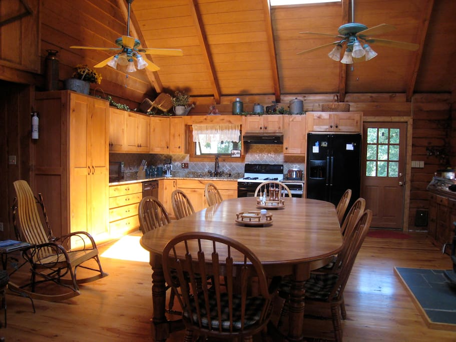 We have a beautiful kitchen with a huge table.