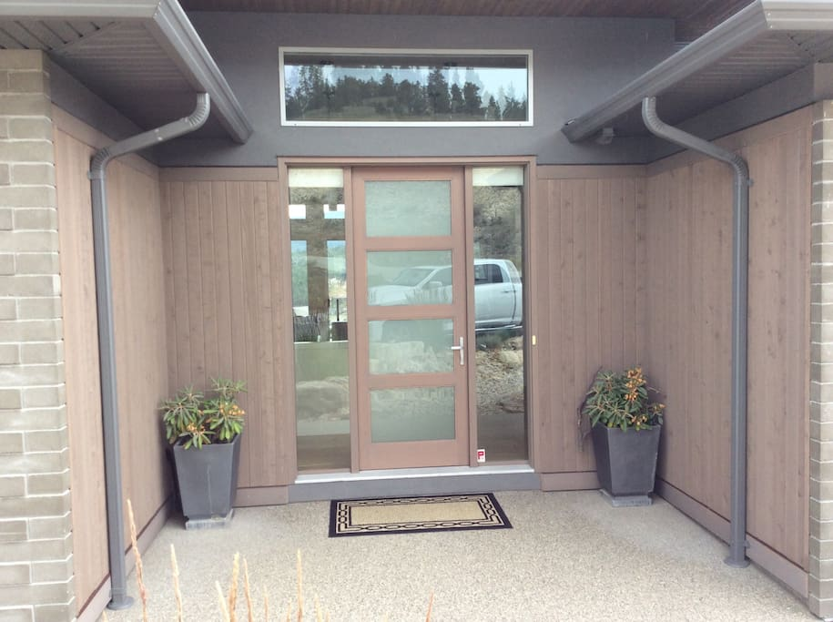 Front Entrance with frosted glass door and full blinds to large windows for beautiful light or full privacy.