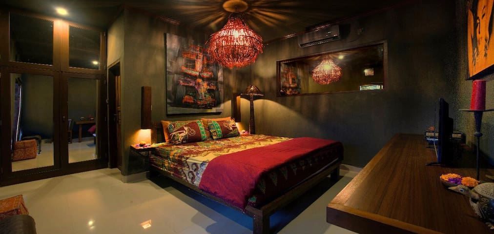 Master Bedroom with Oil Painting and Wide Screen Tv