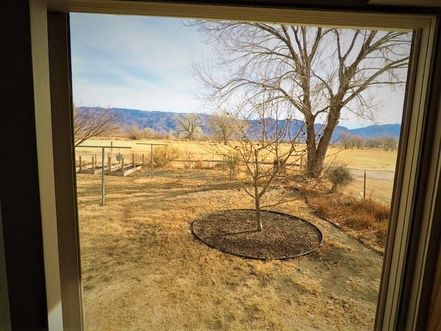 Bedroom with an incredible view of the glorious White Mountains (with trails out your door along the canal!)