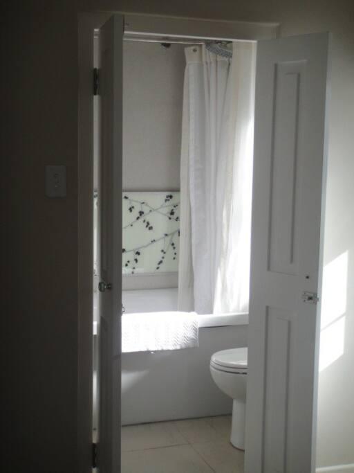 En suite bathroom with bath