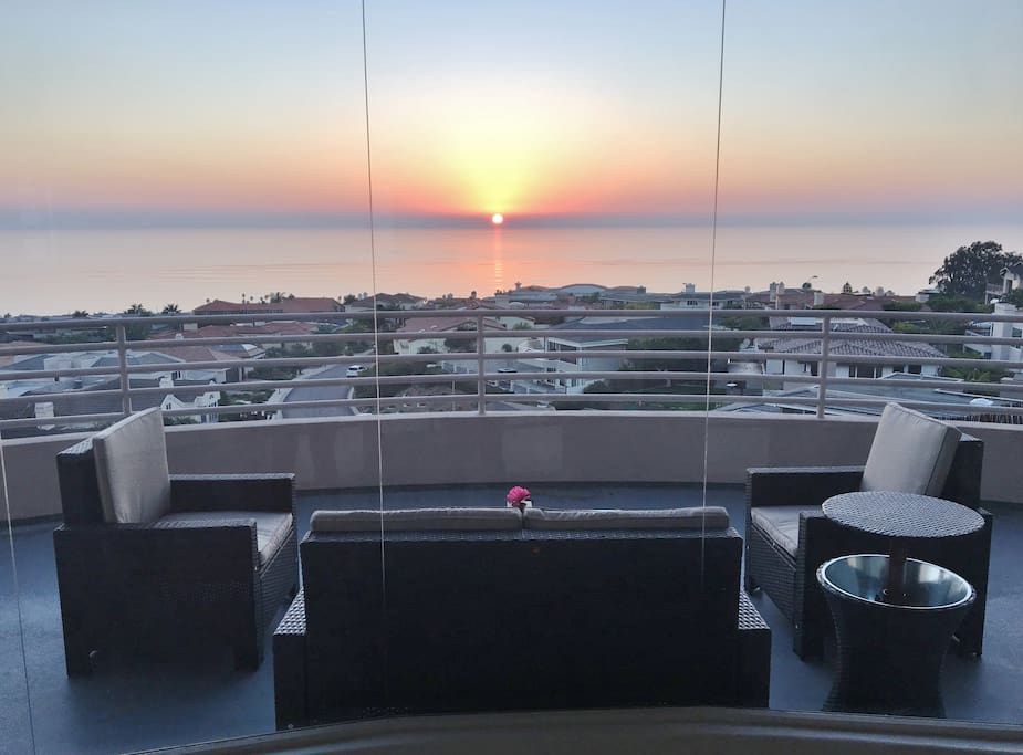 Sunset view from shared front deck.   Guests are welcome to relax in this area and use patio furniture.