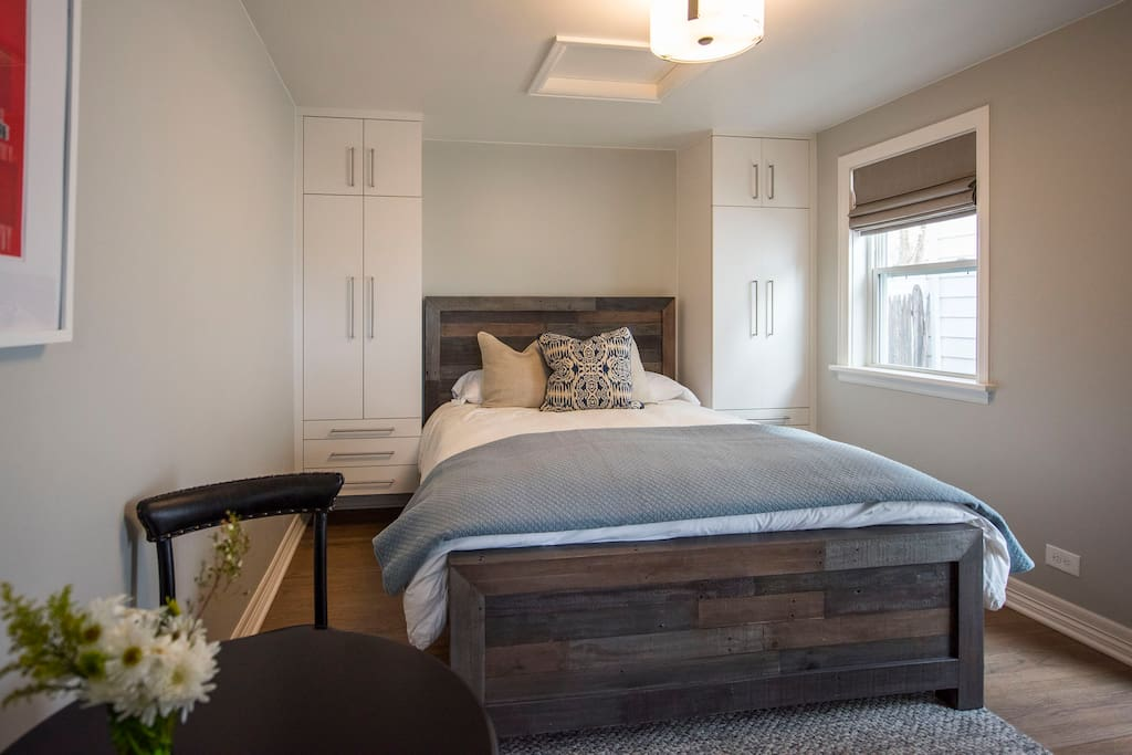 Bedroom with view of closets