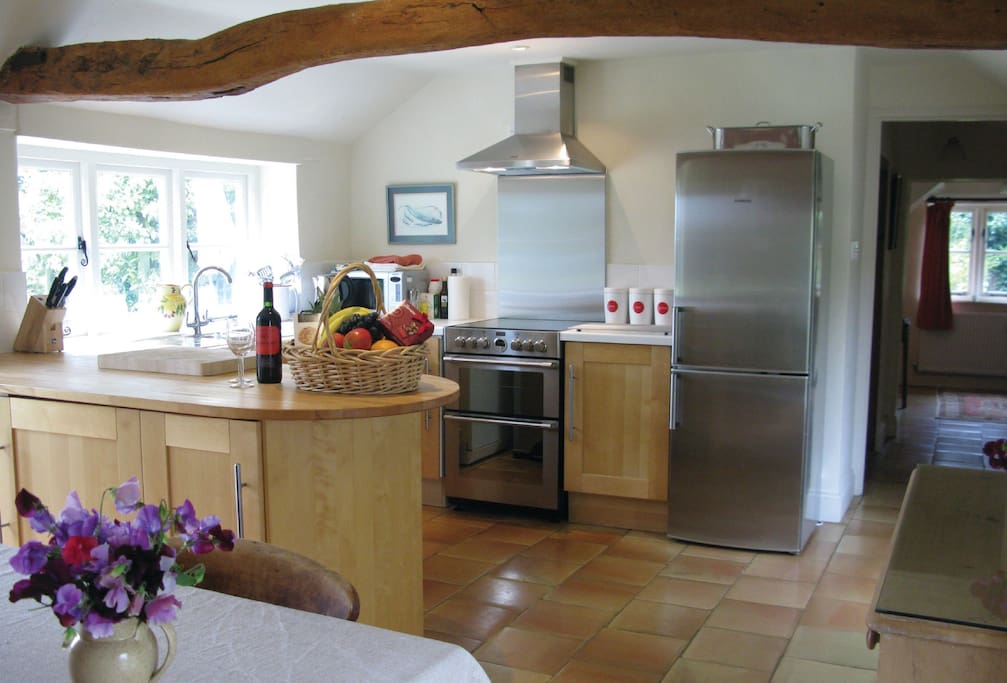 Ground floor: Large kitchen with dining area and french doors to garden and patio