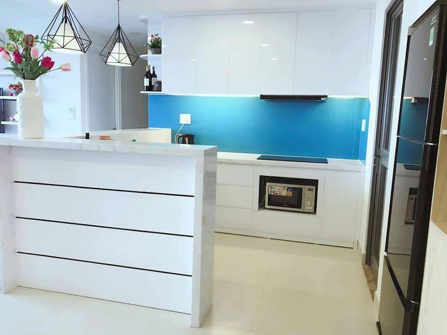Kitchen with modern stove, heat and fridge