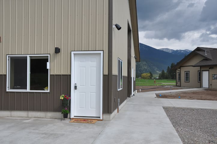 Guest suite is at ground-level and in a separate building from on-site owner.