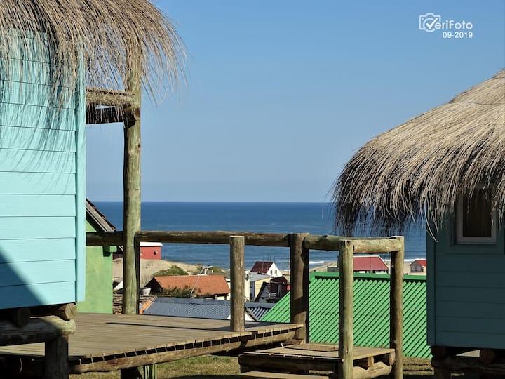 Cabaña con vista al mar y al Faro de la Viuda