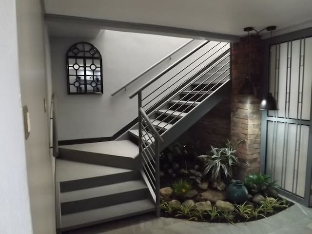 Private entrance, via a stairwell