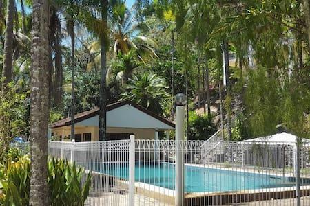 poolhouse set in tropical surroundings