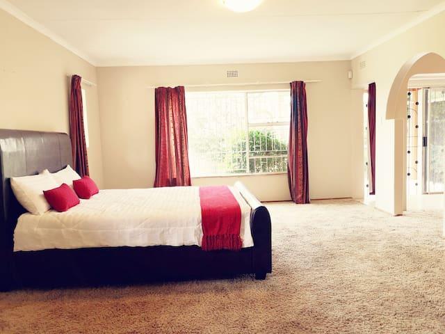 Spacious En-suite Bedroom with an office space