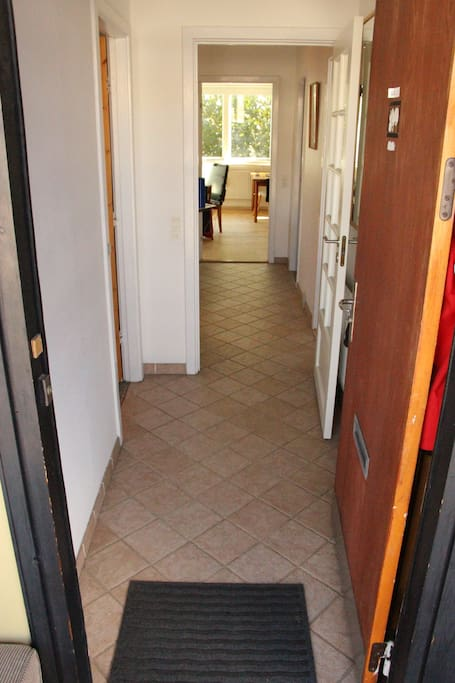 Main entrance to the apartment. (bathroom to the left, bedroom right, kitchen/living room straight ahead)