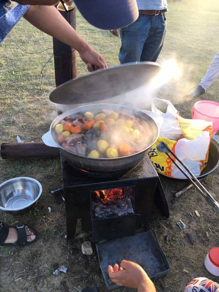 Cooking in progress on outdoor stove