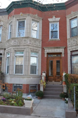 Our brick and limestone rowhouse is in the Prospect Lefferts Gardens historic district. It is just two blocks from the 2,5,B,Q and S metro lines.