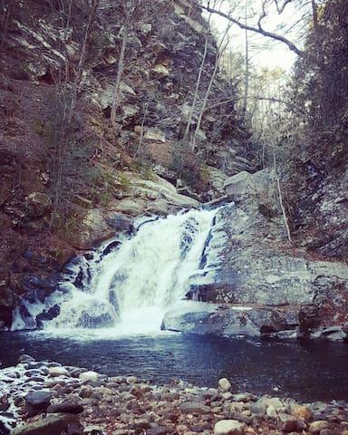 Hear the waterfall roaring directly below the cabin (no access).