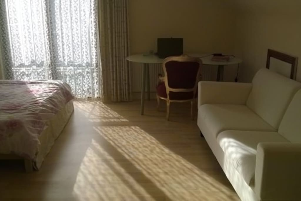 large double bedroom with balcony & ensuit