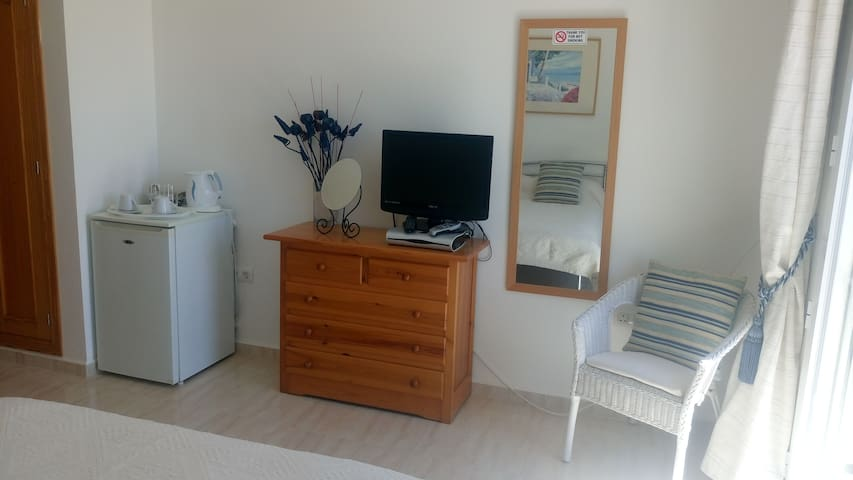 Facilities in your room.  Fridge to keep your wine cool! Satellite TV, Hairdryer in the room.