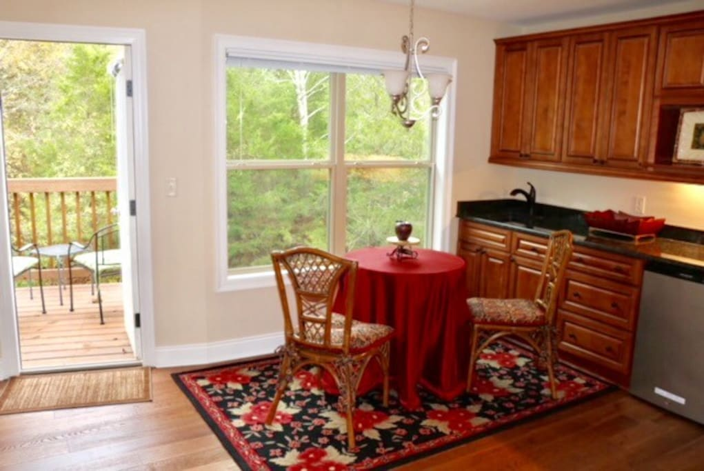 The Retreat offers a small kitchenette with a coffee bar and a bistro table with chairs.