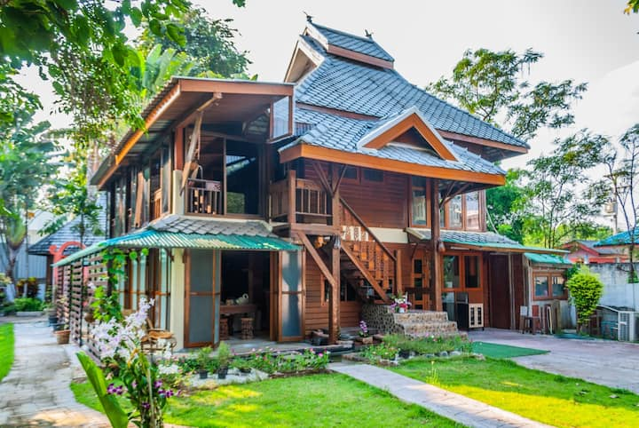 Thai Traditional wooden houses with flower gardens