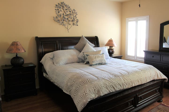 The luxurious master bedroom with large king bed and super soft linens