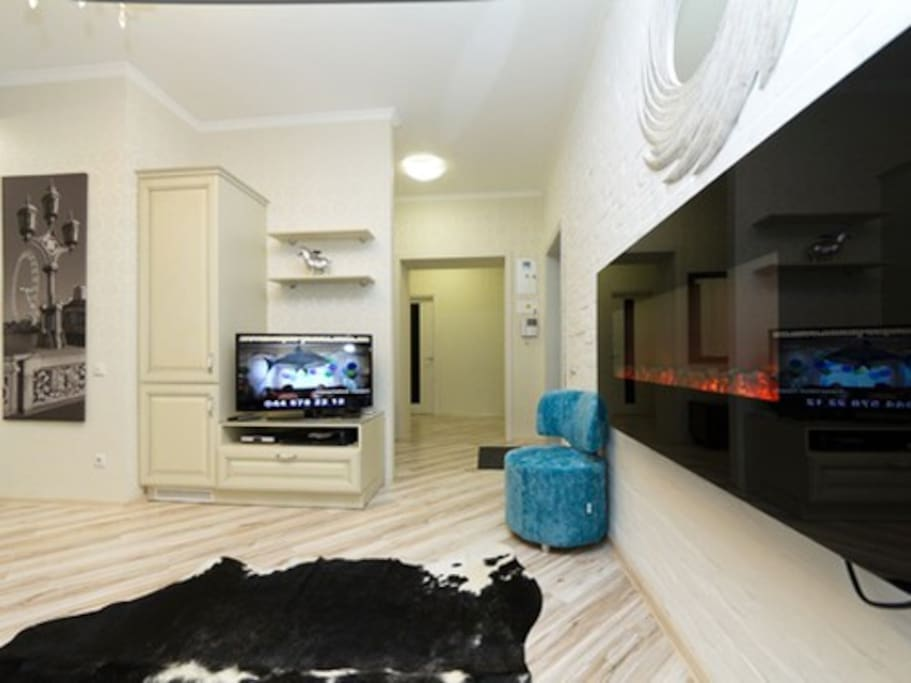 Living-room with fire-place, open studio-kitchen