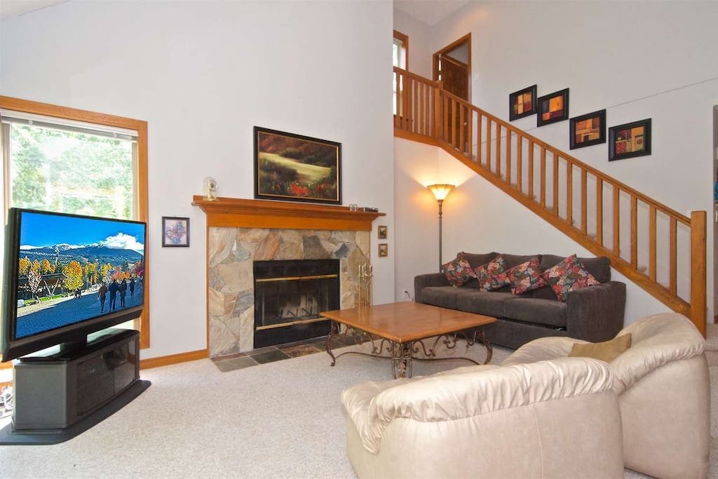 Wood burning fireplace, comfortable seating with sofa bed...note stairs behind go to upper master bedroom suite