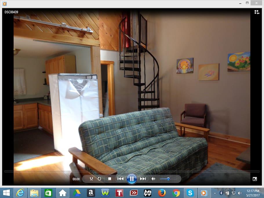 Living room to kitchen, stairways to bedroom