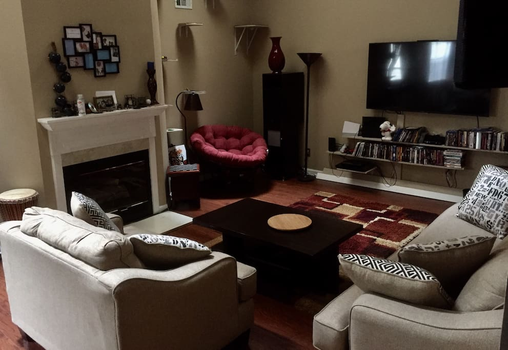 Living room. Fireplace,  Cozy papasan reading chair with lamp, skylights, ceiling fan, entertainment center.