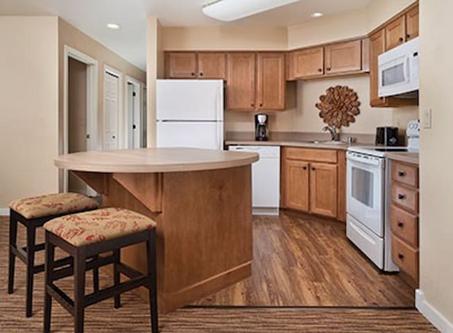 Large Fully Equipped Kitchen with Full-Size Refrigerator, Stove, Oven, Microwave, Dishwasher and Island Opening To Living and Dining Room