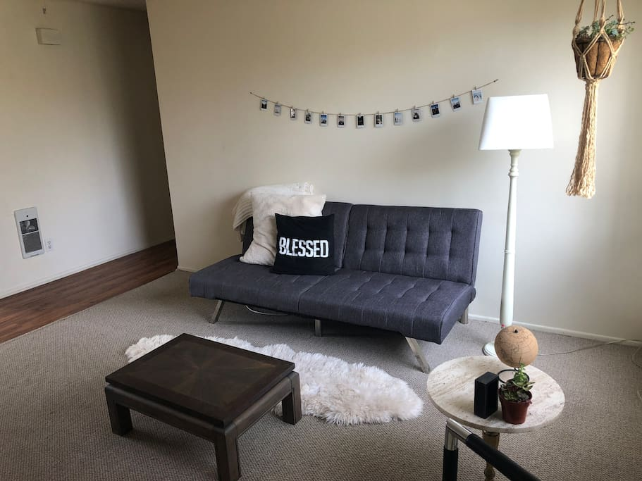 Grey Couch unfolds into single bed!
