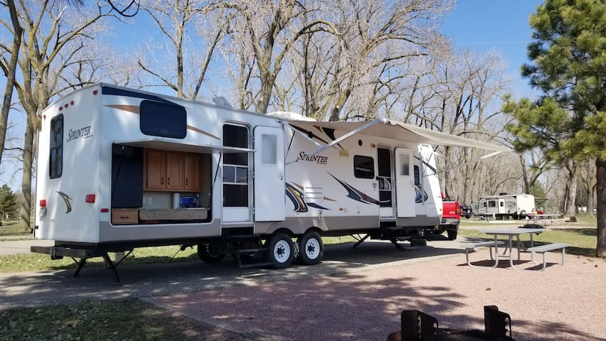 Plan a family camping trip with my travel trailer