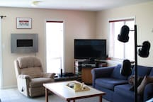Electric fireplace, tv, DVD's, recliner.  Very bright basement suite.