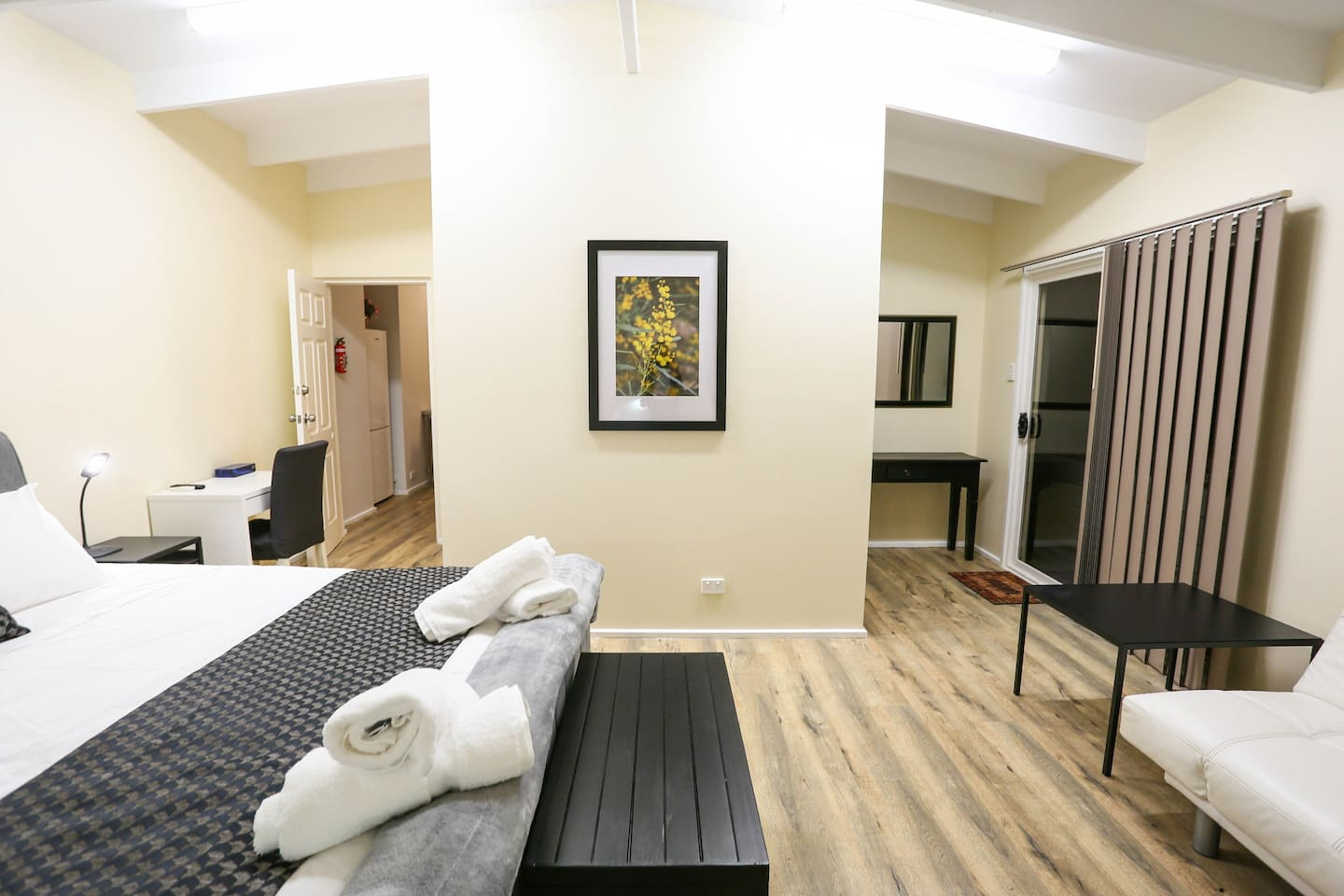 Wattle room features own private outside entry (to the right), access to a private kitchen / laundry area (to the left) an  and ensuite, walk in robe and heating /cooling air conditioner.