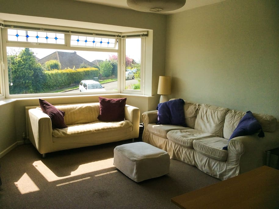Lounge (with blinds pulled up) - it's a lovely light area with comfortable sofas and footstools so that you can put your feet up and relax. There's also a beanbag so there's plenty of space to sit down.