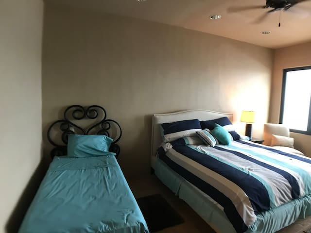 Master Bedroom with King bed and a single