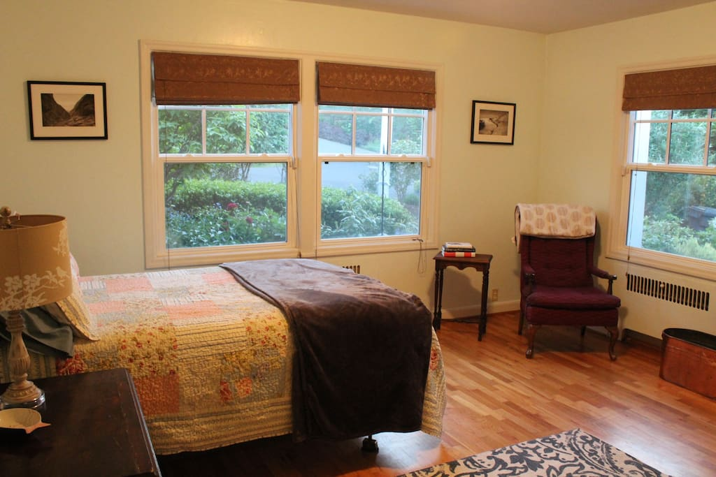 Garden Room is spacious with oak floors, chair, table, dresser and coffee/tea service.