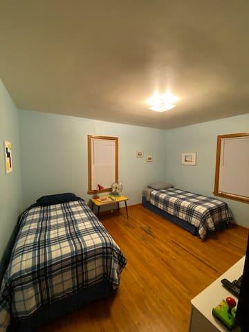 Two single beds in main floor bedroom