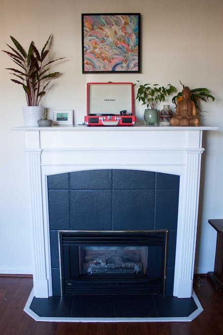 Living room has a gas fireplace.