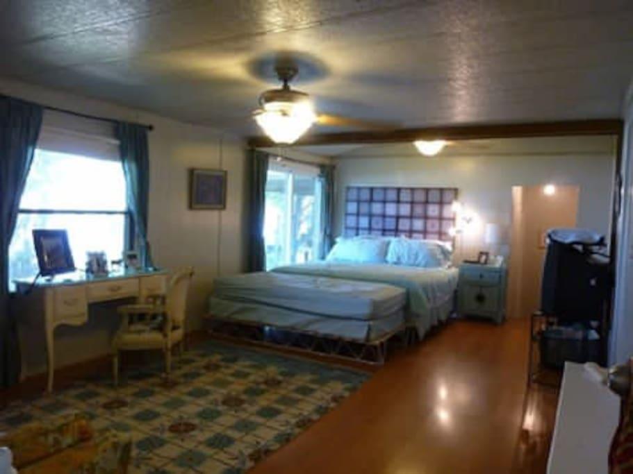 Master bedroom has king, twin, and queen sleeper sofa
