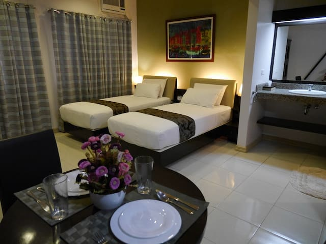 Aster at New Manila Suites - A Full Service BnB - Quezon City