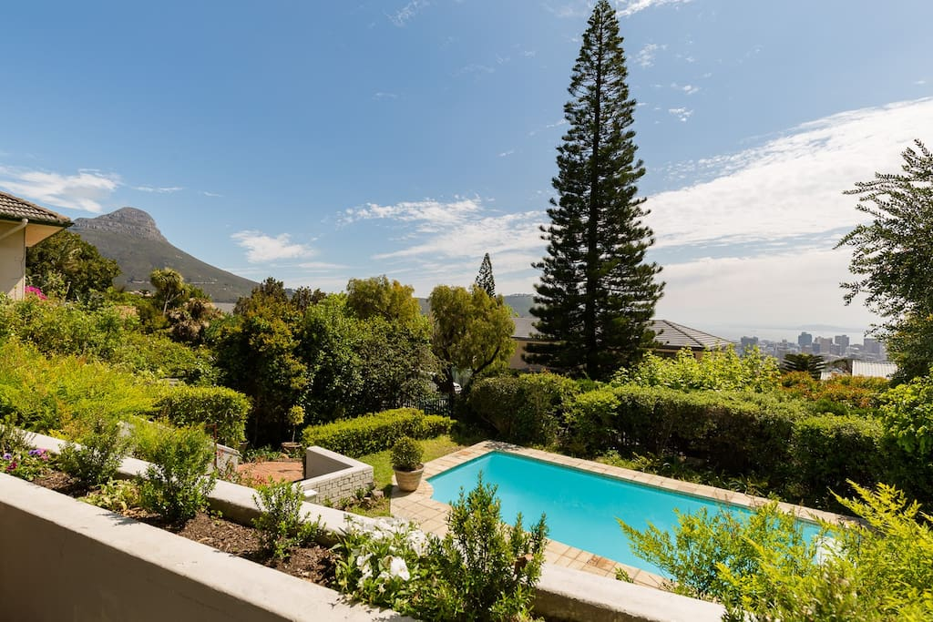 Patio and pool with swooping views of Lions head, the city and Cape Town harbour in the distance