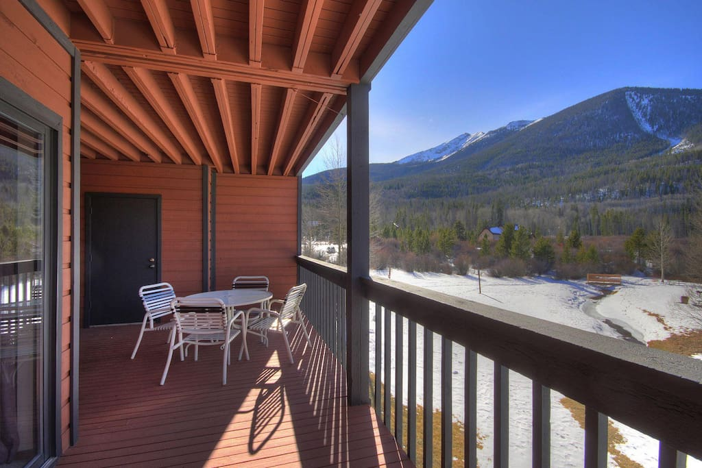 Spacious deck with gorgeous views - Large deck features patio furniture, BBQ and stunning views any season.