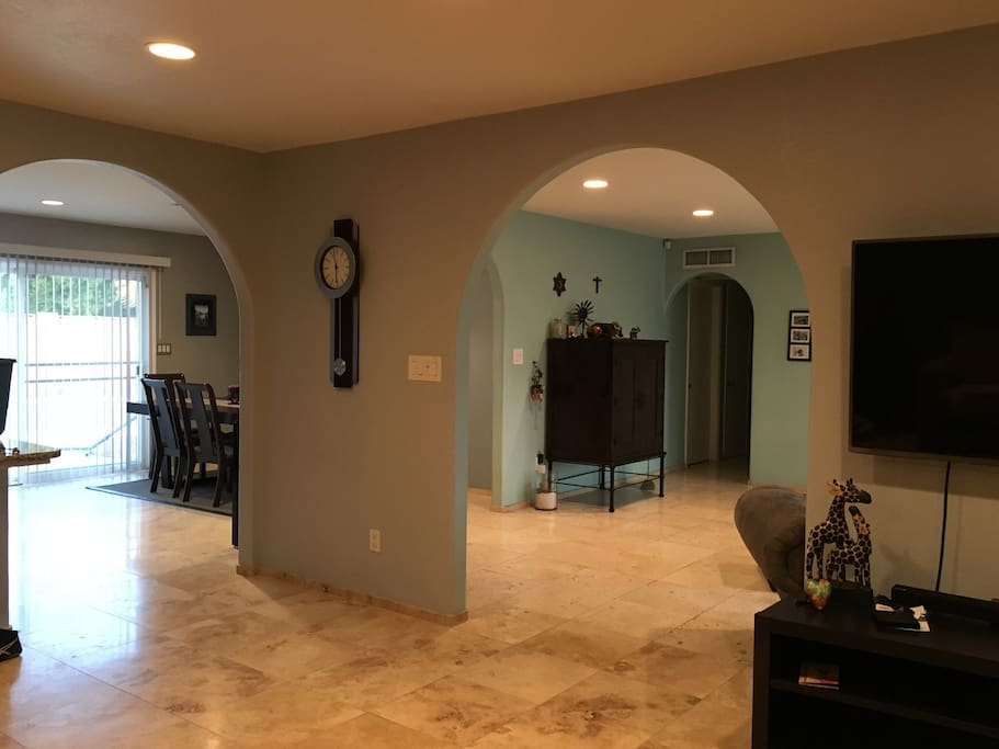View from living room into kitchen area (left) and entry way (right).