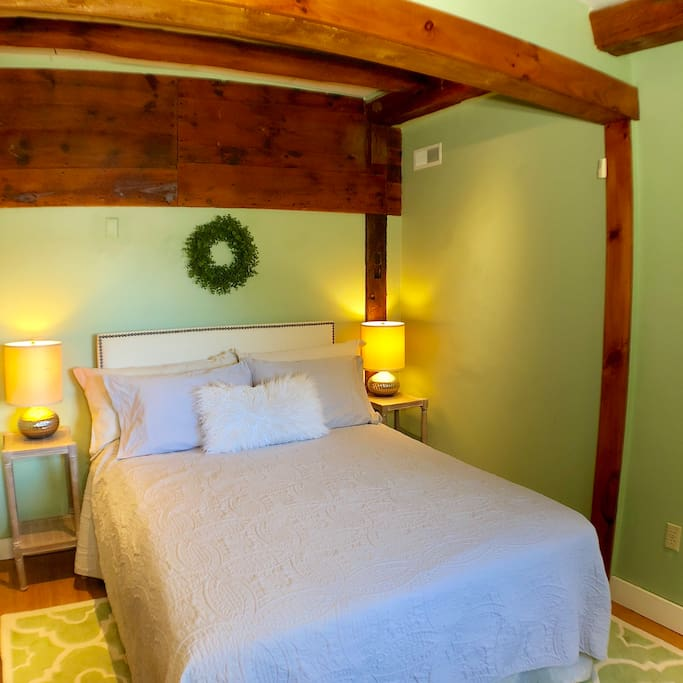The Green Room with its comfy queen bed. This room is a favorite. It is in the back of the apartment and is located next to the bathroom and shower room.