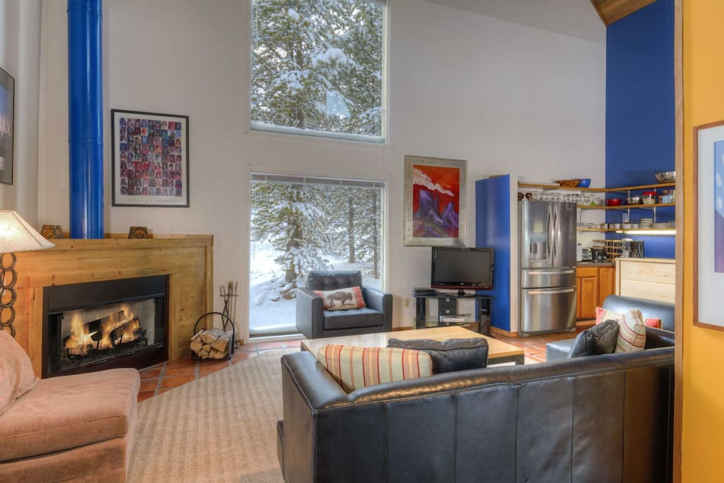 Main living area; wood fireplace; flat screen TV; Leather couches
