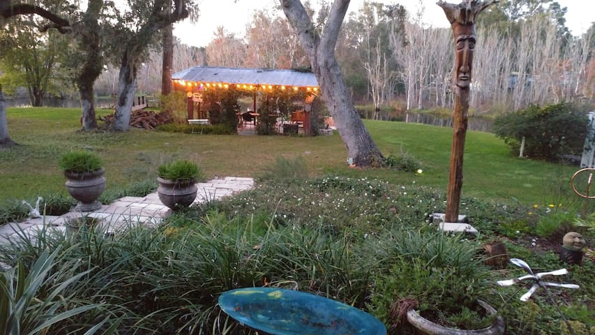 """Backyard facing water. The first building is our """"cook shed"""", were you can  BBQ."""