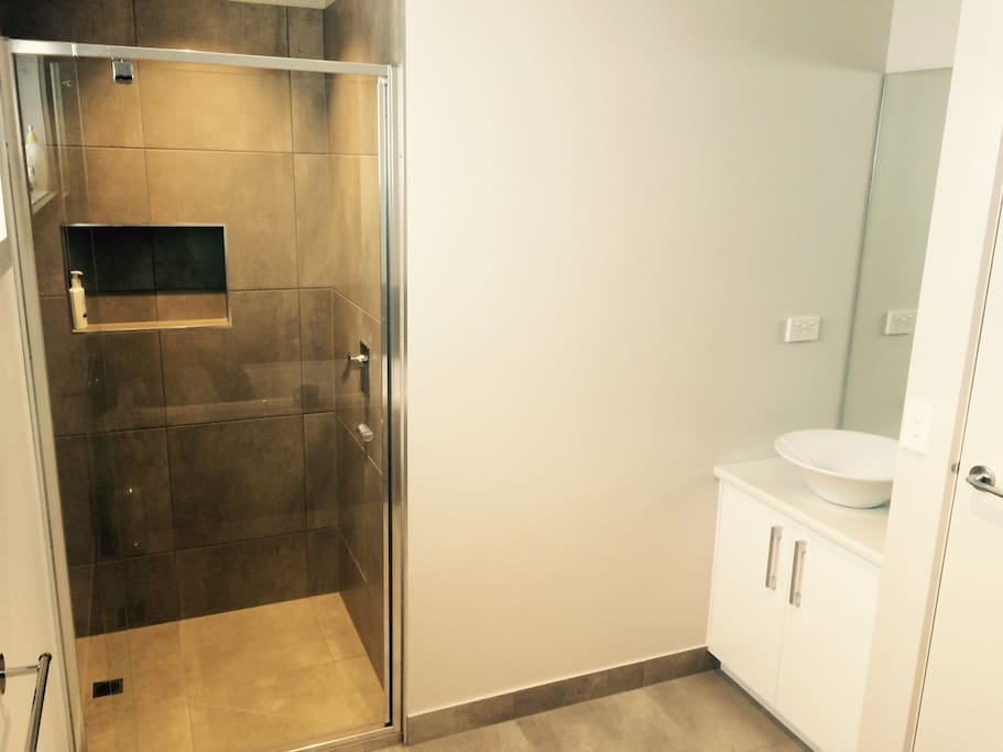 Bathroom with shower and bath