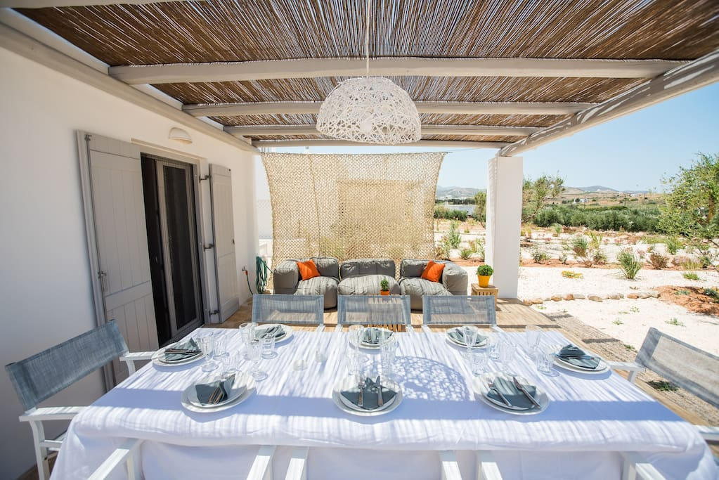The villa's outdoor shaded living and dining area