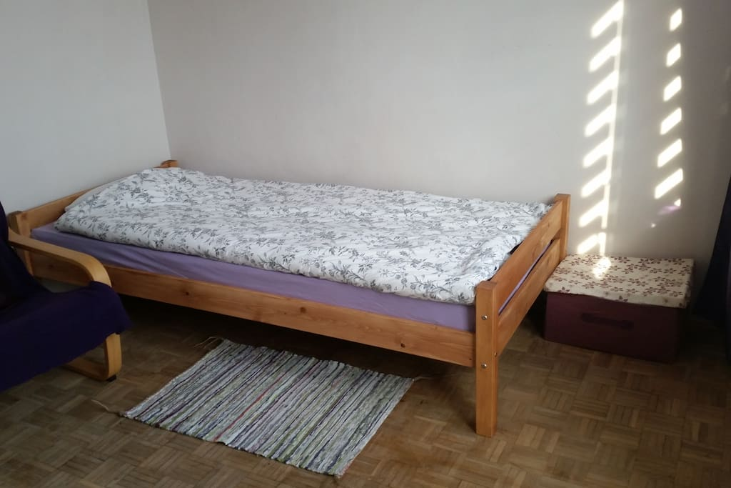 Single bed with two easy chairs