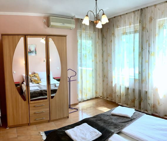 Bedroom with huge sunny windows, shutters & AC
