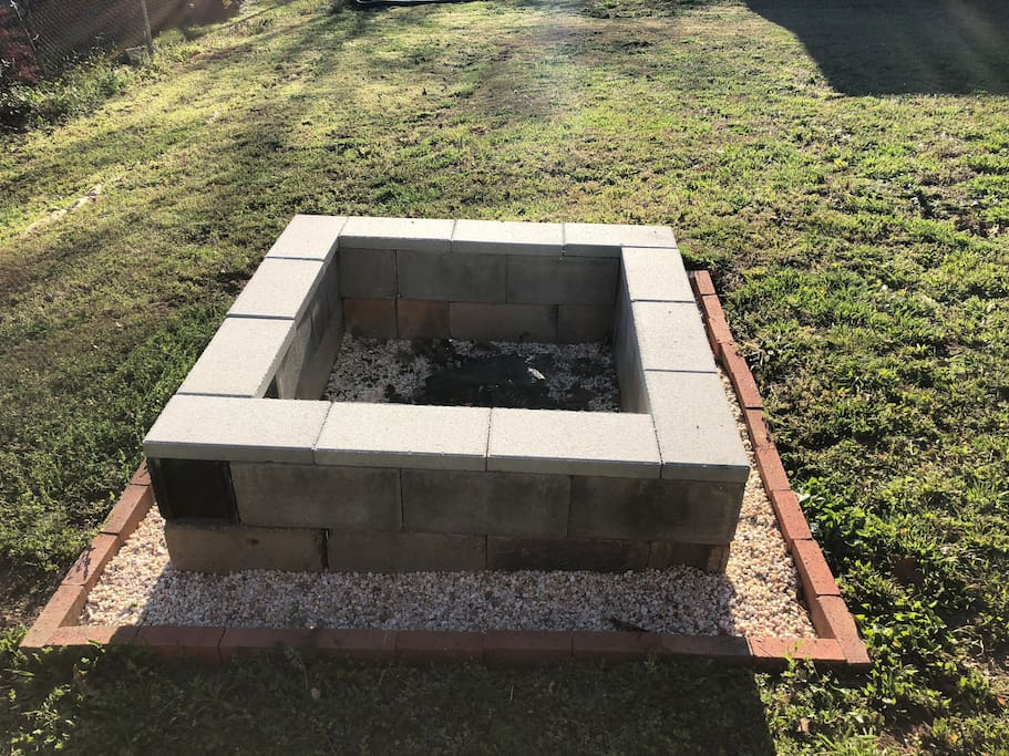 Fire pit in backyard, feel free to use it!